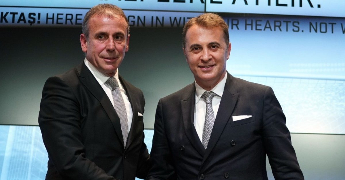 Abdullah Avcu0131 (L) and Beu015fiktau015f chair Fikret Orman shake hands at a press conference June 10, 2019.