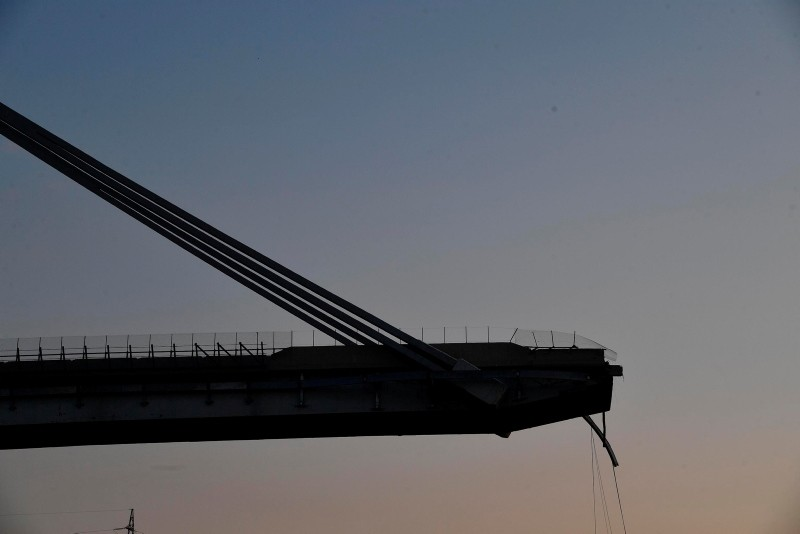 A view of the partially collapsed Morandi highway bridge in Genoa, Italy, Thursday, Aug. 16, 2018. (AP Photo)