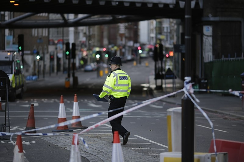A police officer walks through a closed street in the London Bridge area of London, Tuesday, June 6, 2017. (AP Photo)