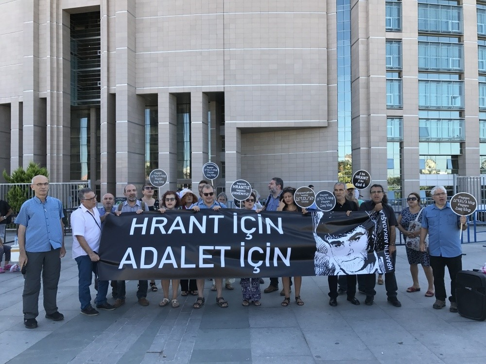 Activists carry a photo of Hrant Dink with a banner reading ,For Hrant, For Justice.,