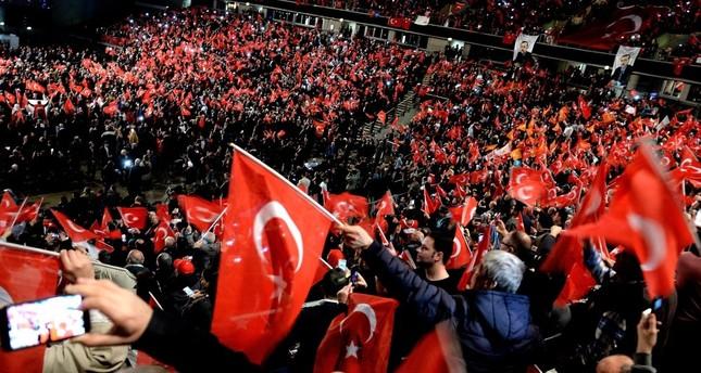 Participants waving Turkish flags at a meeting on the April referendum, held by Prime Minister Binali Yılırım in Oberhausen, Germany, Feb. 18.