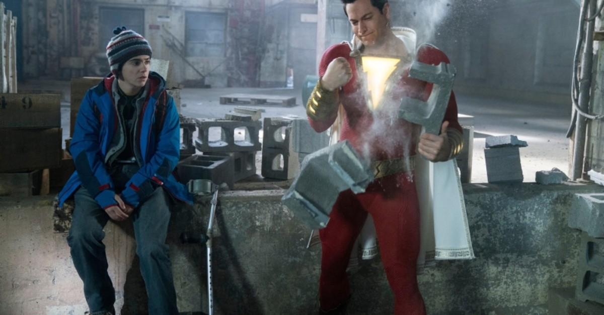 This image released by Warner Bros. shows Zachary Levi, right, and Jack Dylan Grazer in a scene from ,Shazam!, (Steve Wilkie/Warner Bros. Entertainment via AP)