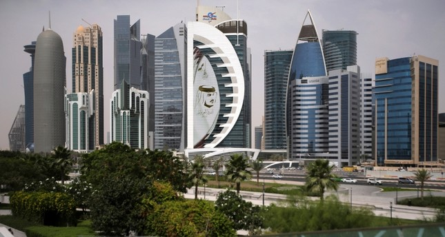 In this May 5, 2018, file photo, a giant image of the Emir of Qatar Sheikh Tamim bin Hamad Al Thani, adorns a tower in Doha, Qatar. (AP Photo)