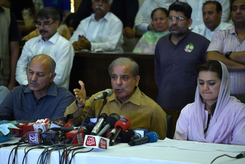 Shahbaz Sharif (C), the younger brother of ousted Pakistani PM Nawaz Sharif and the head of Pakistan Muslim League-Nawaz (PML-N), gestures as he speaks during a press conference at his political office in Lahore on July 25, 2018. (AFP Photo)