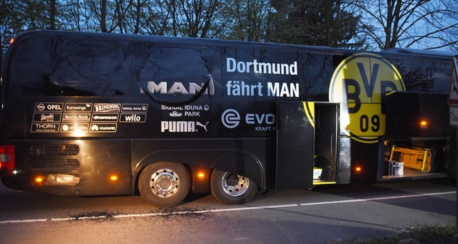 Borussia Dortmund's damaged bus is pictured after an explosion some 10km away from the stadium prior to the UEFA Champions League 1st leg quarter-final football match BVB Borussia Dortmund v Monaco in Dortmund, Germany on April 11, 2017. (AFP Photo)