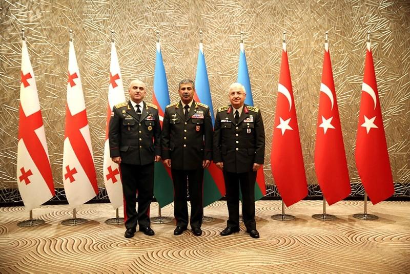 Azerbaijanu2019s Defense Secretary Col. Gen. Zakir Hasanov (C), Turkish Chief of General Staff Gen. Yau015far Gu00fcleru00a0(R) and his Georgian counterpart Maj. Gen. Vladimeru00a0Chachibaia. (AA Photo)