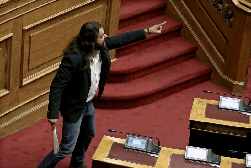 Golden Dawn lawmaker Constantinos Barbaroussis argues with lawmakers during a debate in the Greek parliament in Athens, Greece, June 15, 2018. (EPA Photo)