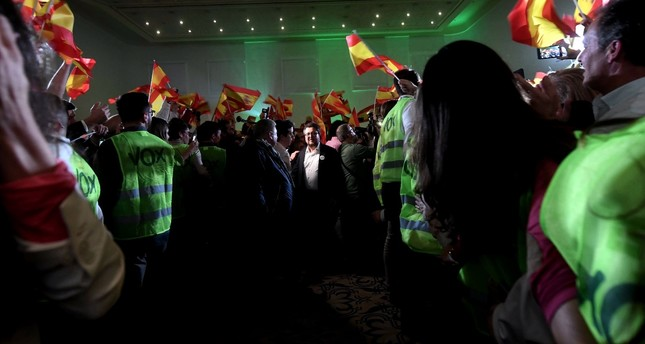 The Spanish far-right party VOX's candidate for the Andalusian regional presidency, Francisco Serrano (C, rear), walks among supporters during an election night party in Seville, Andalusia, southern Spain, Dec. 2.