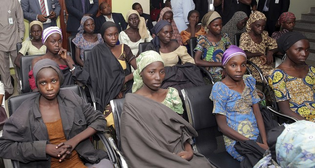 In this Thursday, Oct. 13, 2016 file photo released by the Nigeria State House, Chibok schoolgirls recently freed from extremist captivity are seen during a meeting with Nigeria's Vice President Yemi Osinbajo in Abuja. (AP Photo)