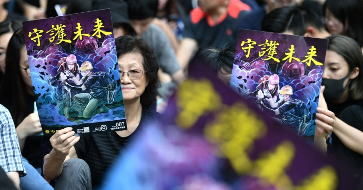 People attend a protest in the Western district of Hong Kong on August 4, 2019, in the latest opposition to a planned extradition law that has quickly evolved into a wider movement for democratic reforms. (AFP Photo)