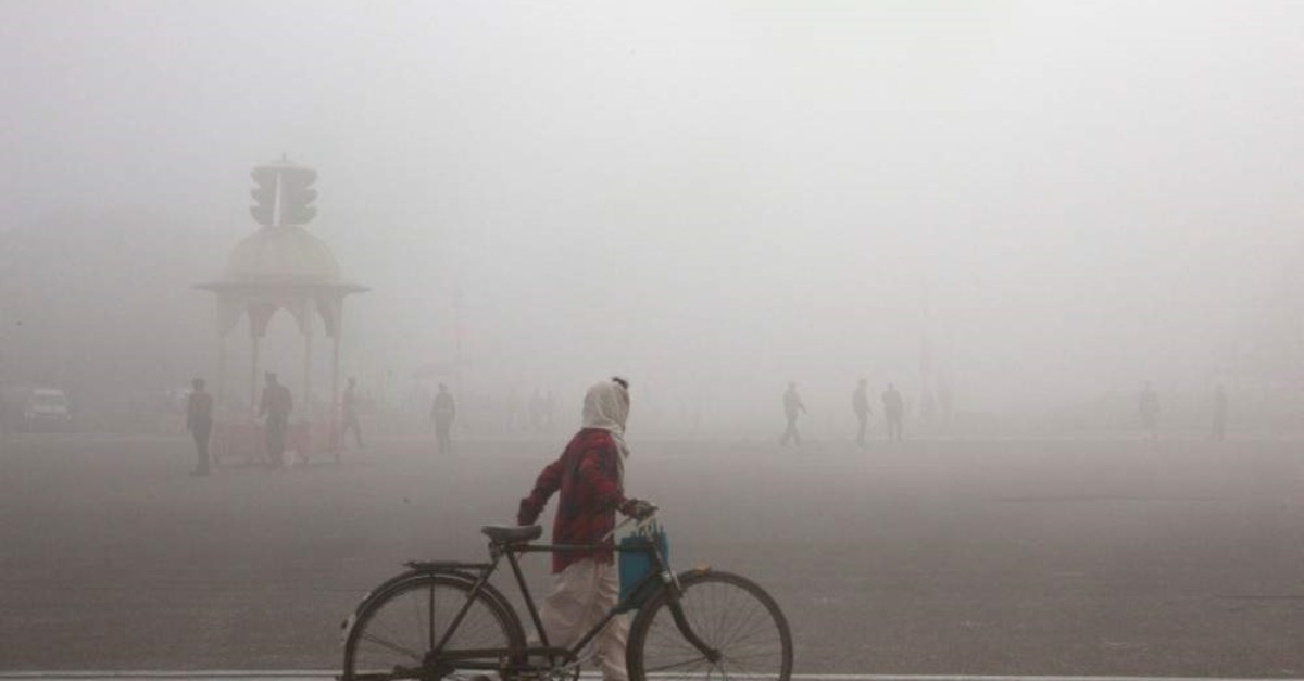 This Jan. 18, 2019 file photo shows a cyclist amid morning smog in New Delhi, India. (AP Photo)