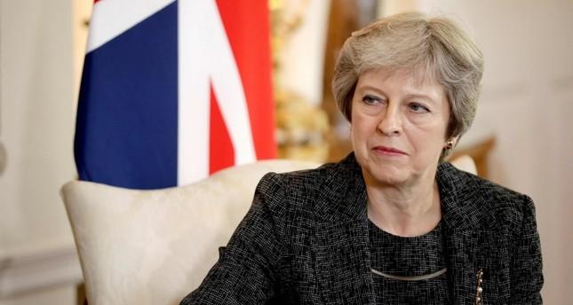رئيسة الوزراء البريطانية، تيريزا ماي أثناء اجتماع مع أمير قطر تميم بن حمد في لندن 24 يوليو 2018  (وكالة الأنباء الفرنسية)