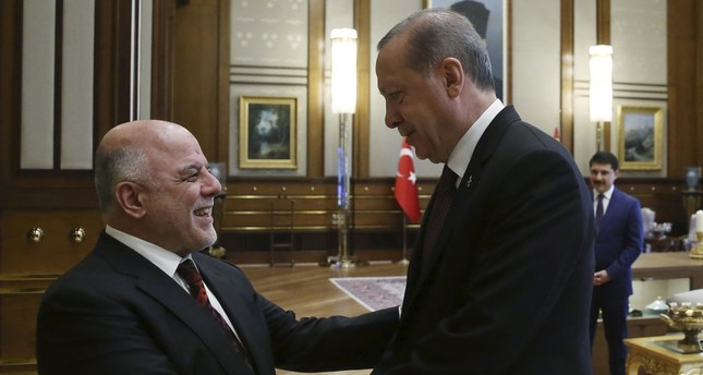 President Recep Tayyip Erdoğan greets Iraqi Prime Minister Haider al-Abadi before a meeting at the Beştepe Presidential Complex in Ankara, October 2017.