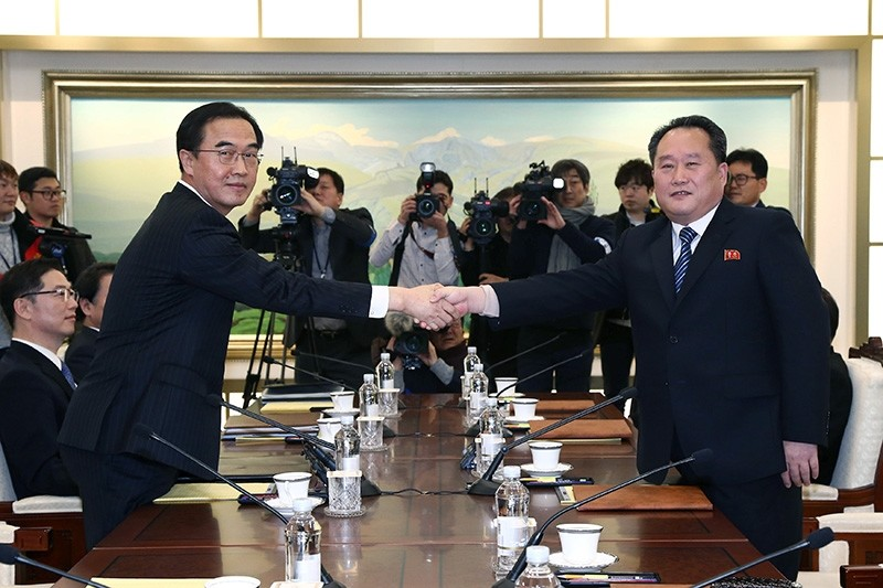 Head of the North Korean delegation, Ri Son Gwon shakes hands with his South Korean counterpart Cho Myoung-gyon during their meeting at the truce village of Panmunjom in the demilitarised zone separating the two Koreas. (Reuters Photo)