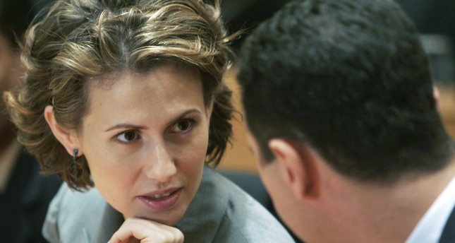 In this 2008 file photo, Bashar Assad, right, listens to his wife Asma Assad during their visit to the campus of Infosys Technologies Ltd in Bangalore, India. (AP Photo)