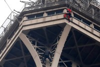 Eiffel Tower evacuated after man tries to climb up