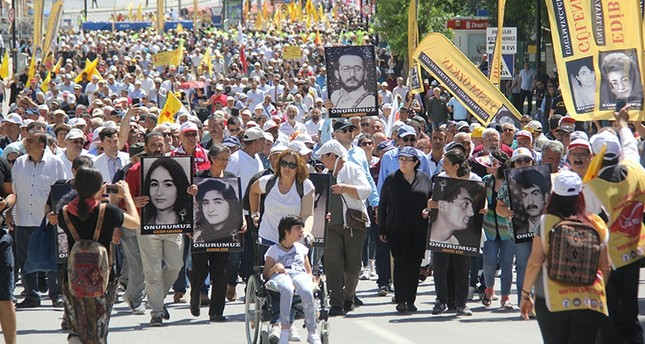 A crowd holding pictures of the victims commemorate the 25th anniversary of the Sivas Massacre in Sivas, Turkey on July 2, 2018. (AA Photo)