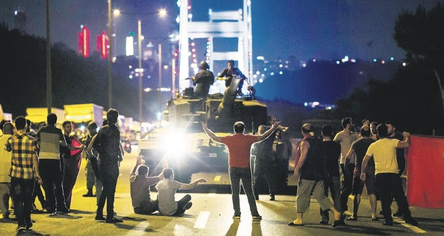 People confront a tank controlled by putschists during the 2016 coup attempt in Istanbul. Soldiers sheltered by Greece took part in the coup's Istanbul leg.