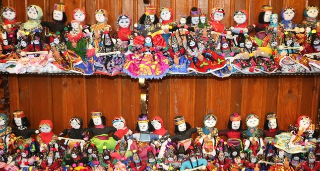 Ezo Gelin dolls stand out with their traditional clothing.
