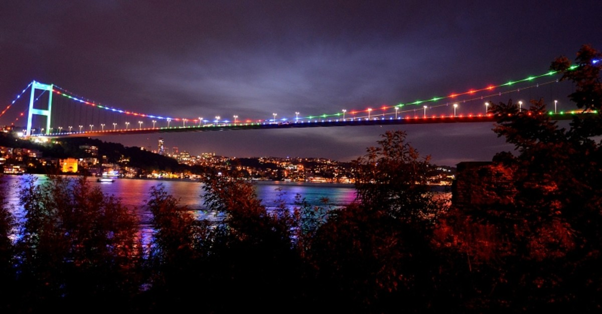 The Fatih Sultan Mehmet Bridge in Istanbul lit by colors of Azerbaijani flag on the 101st anniversary of the foundation of Azerbaijan Democratic Republic, on May 27, 2019. (AA Photo)