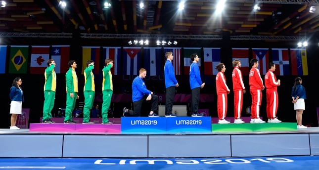 U.S.' Race Imboden (4th from L) kneels during the national anthem at the Men's Foil Team medal ceremony in Fencing, at the Lima Convention Center during the Pan American Games Lima 2019 in Lima on Aug. 9, 2019. (AFP Photo)