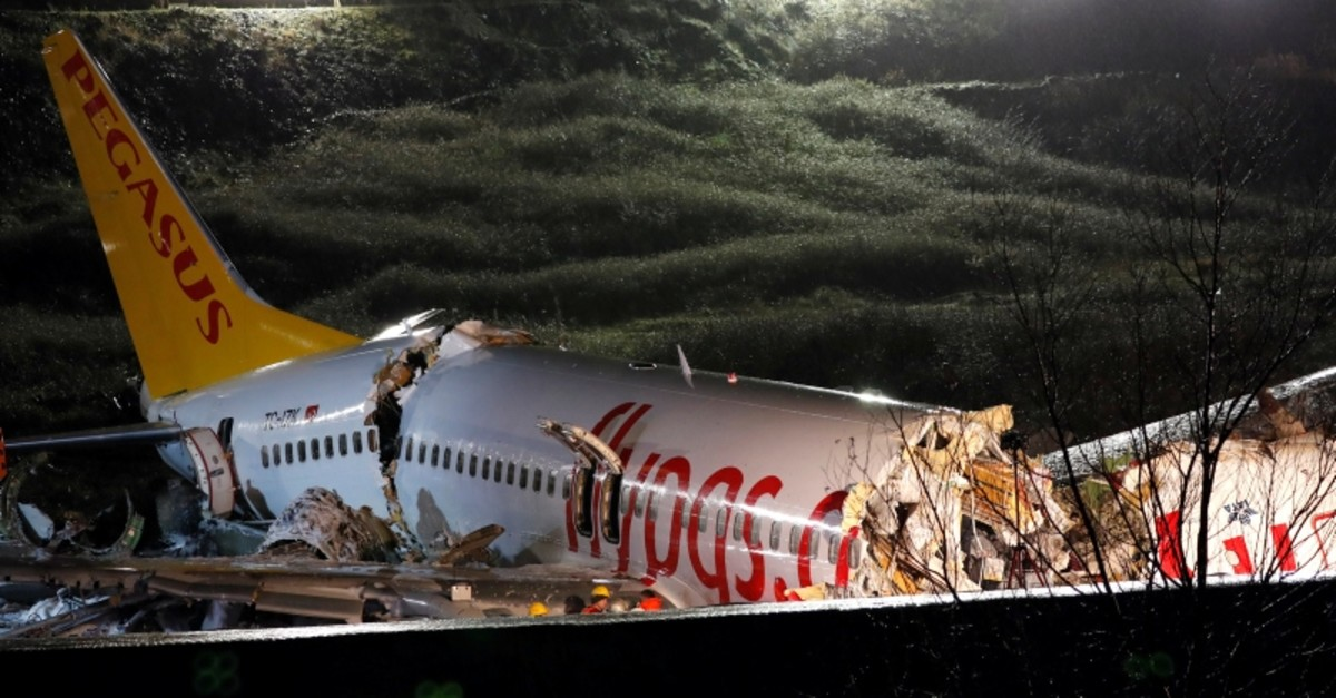 A view of the Pegasus Airlines Boeing 737-86J plane, that overran the runway during landing and crashed, at Istanbul's Sabiha Gokcen airport, Turkey February 5, 2020. (Reuters Photo)