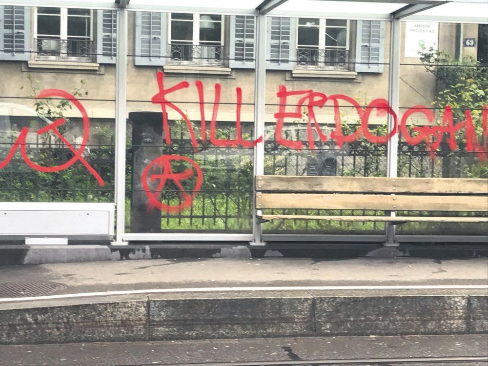 Graffiti reading ,Kill Erdou011fan, on a bus stop near the Turkish Consulate General in Zurich, Switzerland, May 1. On the same day, the consulate was also vandalized with paint.
