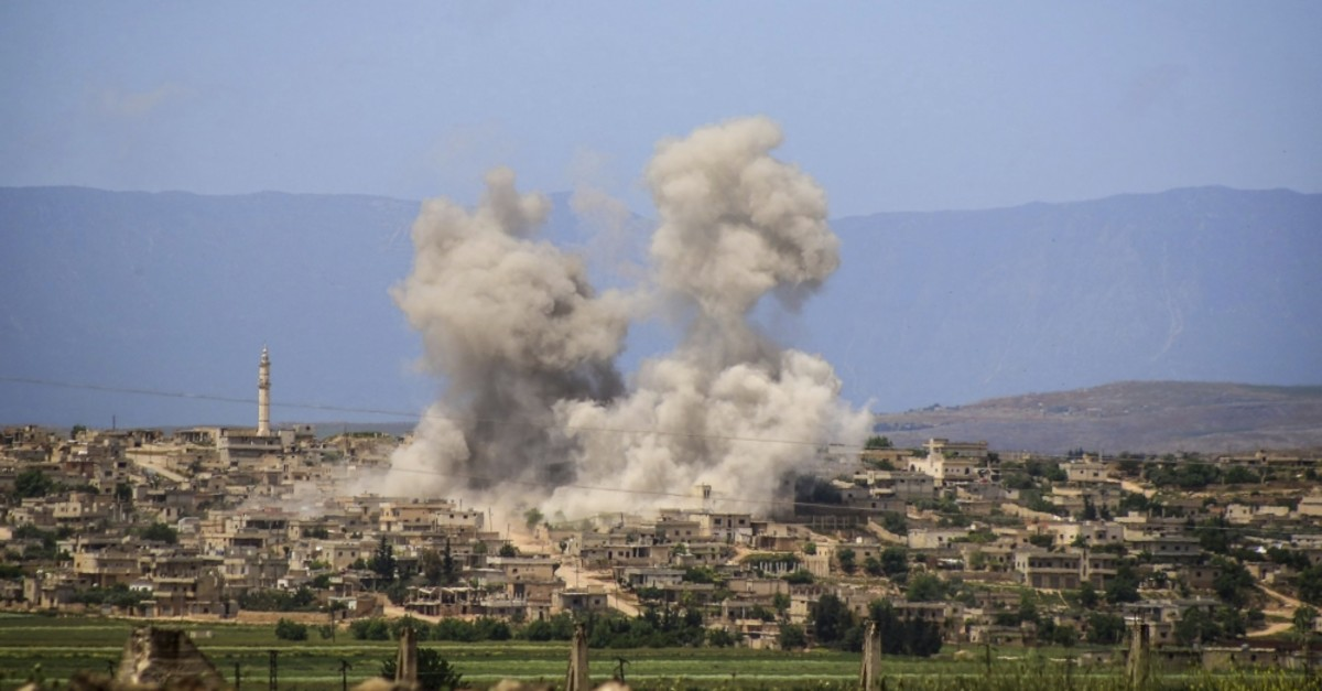 Smoke rises after Syrian regime and Russian airstrikes hit the town of al-Habeet, southern Idlib, June 7, 2019.