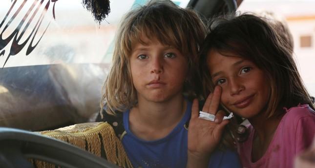 أطفال نازحون من إدلب (الفرنسية)