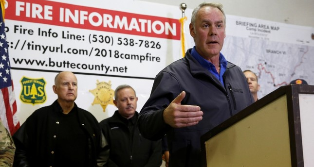 U.S. Secretary of the Interior Ryan Zinke, right, responds to a reporters question during a news conference held with California Gov. Jerry Brown, left, after touring the fire ravaged town of Paradise, Calif, Wednesday, Nov. 14, 2018. (AP Photo)