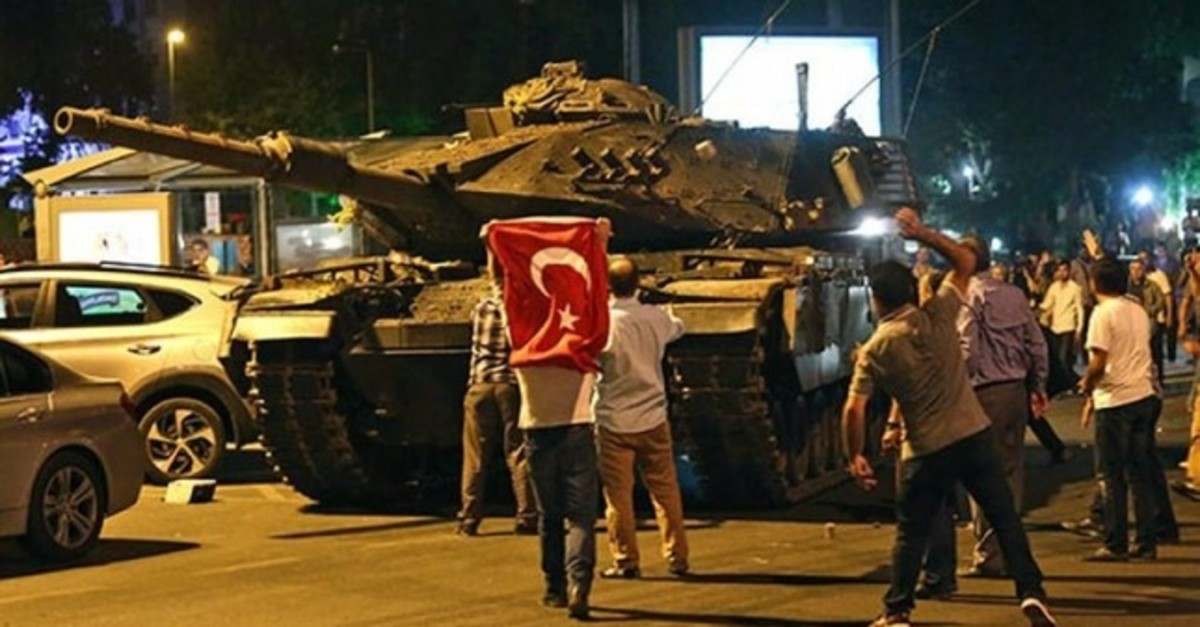 People confront a tank controlled by putschists in Istanbul on July 15, 2016.