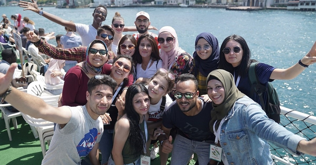 Foreign students who took the Turkish Summer School program of the Yunus Emre Institute in 2018 summer pose for a photo in Istanbul.
