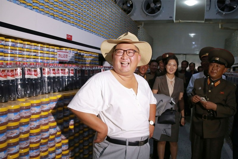 This undated photo released by NKorea's official Korean Central News Agency (KCNA) on Aug. 8, 2018 shows North Korean leader Kim Jong Un inspecting the Kumsanpho Fish Pickling Factory in South Hwanghae Province, North Korea. (AFP Photo/KCNA via KNS)