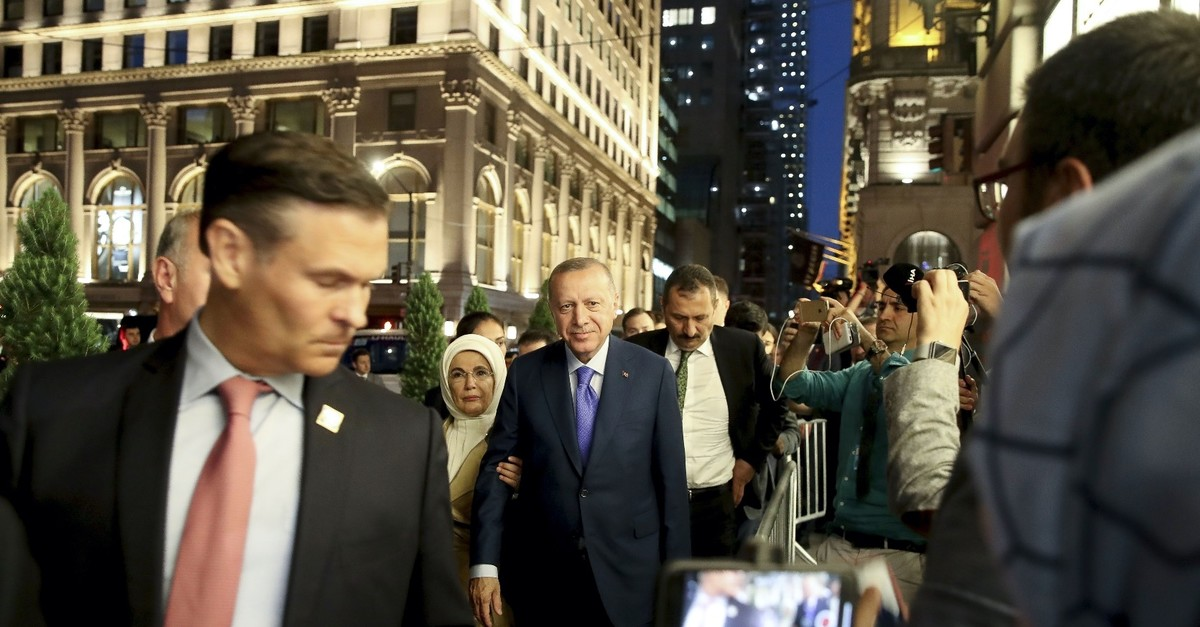 President Recep Tayyip Erdou011fan (C) and his wife, first lady Emine Erdou011fan, are welcomed by Turkish people in New York City, where he has arrived in to attend the U.N. General Assembly, Sept. 21, 2019.