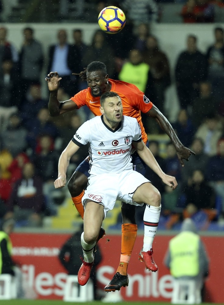 Bau015faku015fehir's Togolese star Emmanuel Adebayor and Beu015fiktau015f's Serbian defender Dusko Tosic vie for the ball.