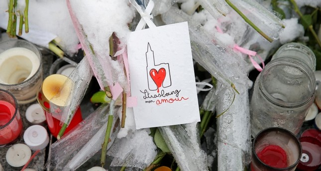 A drawing representing Strasbourg's cathedral is seen at an improvised memorial in tribute to the victims the shooting in Strasbourg, France, December 16, 2018. The sign reads Strasbourg my love. (REUTERS Photo)