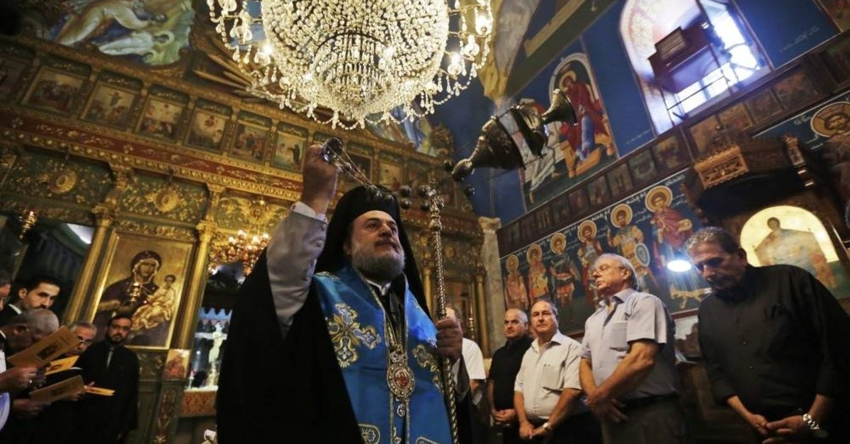 The Greek Orthodox archbishop of Gaza performs a memorial for a Palestinian Christian woman killed in an Israeli strike, Gaza City, Aug. 10, 2014. (AP Photo)