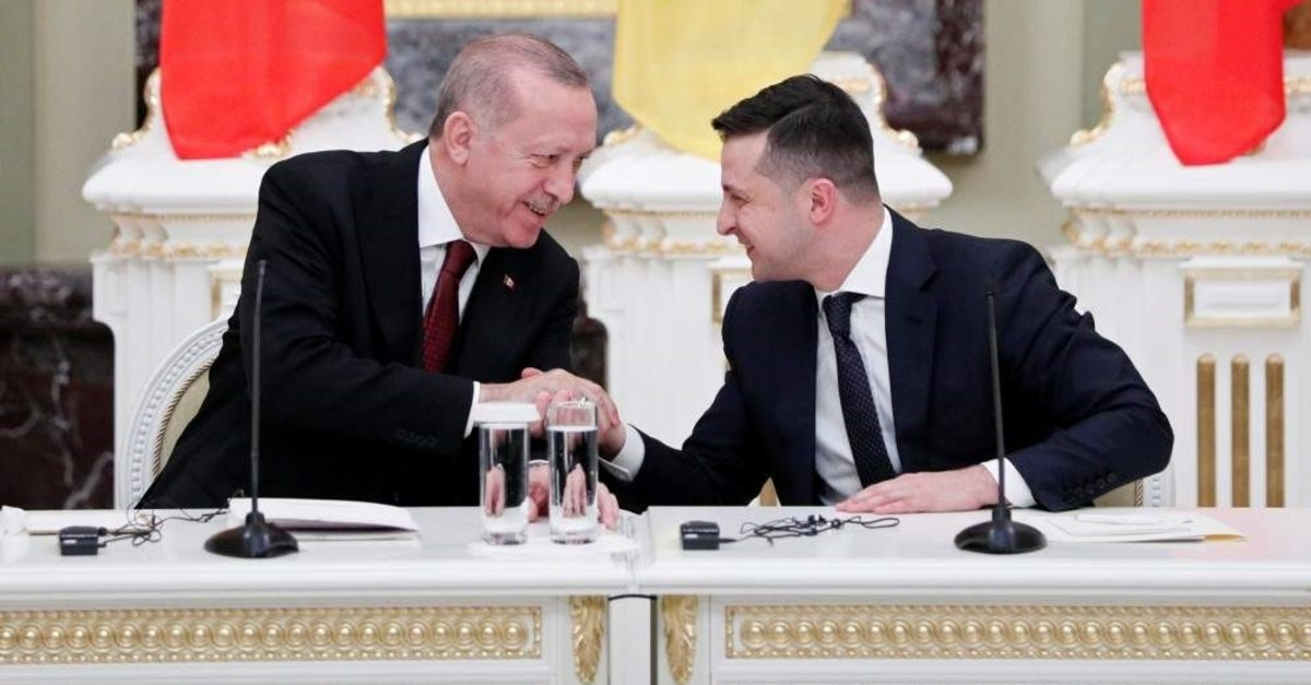 President Recep Tayyip Erdo?an (L) and his Ukrainian counterpart Volodymyr Zelensky shake hands during a joint news conference following their meeting at the Mariyinsky Palace in Kyiv, Ukraine, Feb. 3, 2020. (Reuters Photo)