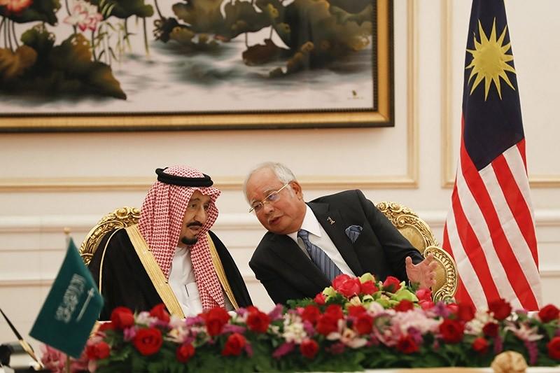 Saudi King Salman, left, listens to Malaysian Prime Minister Najib Razak during the MOU signing ceremony in Putrajaya, Malaysia, Monday, Feb. 27, 2017. (AP Photo)
