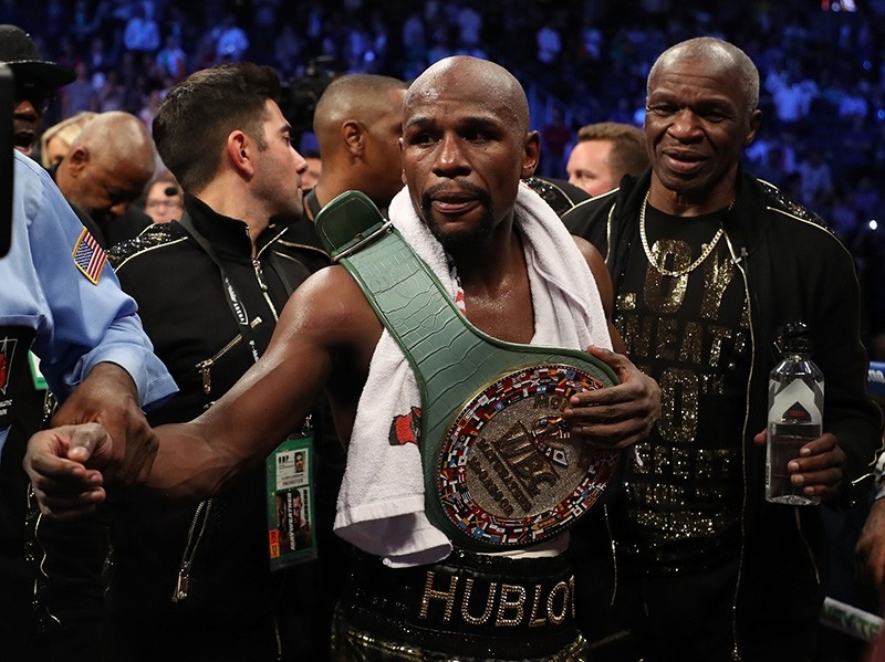 Floyd Mayweather Jr. celebrates after his TKO of Conor McGregor in their super welterweight boxing match on August 26, 2017 at T-Mobile Arena in Las Vegas, Nevada. (AFP Photo)