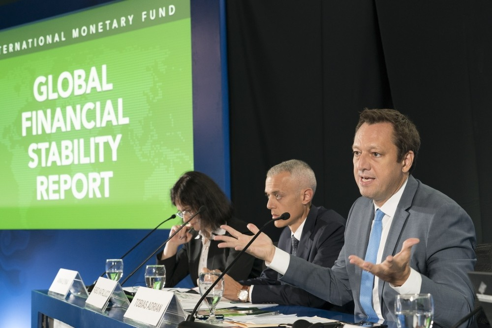 Tobias Adrian (R), IMF Financial Economic Counsellor and Director of the Monetary and Capital Markets Department, speaks at the Global Financial Stability Report press briefing at the 2018 IMF/World Bank Annual Meetings