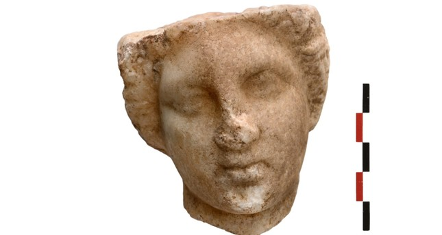 A handout photo made available by the Greek Ministry of Culture on 04 September 2018 shows the head of a marble statue of ancient Greek goddess Aphrodite found during excavations on the island of Kythnos from June 24 to August 4, 2018. (EPA Photo)
