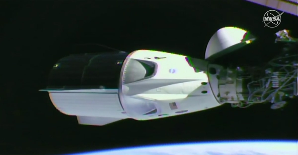 Screengrab from Nasa TV shows SpaceX Crew Dragon capsule docked with International Space Station, March 3, 2019. (NASA Photo)