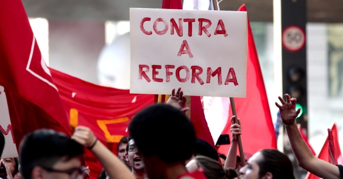People demonstrate during a general strike called by trade unions over Brazilian President Jair Bolsonaro's pension reforms, at Paulista Avenue, Sao Paulo, Brazil, June 14, 2019. (AFP Photo)