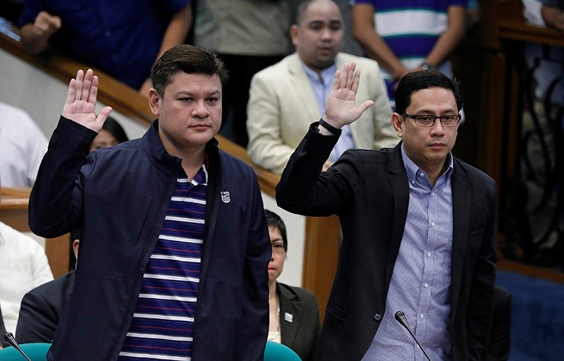 Paolo Duterte, Davao Vice Mayor and son of President Rodrigo Duterte, and his brother-in-law Manases Carpio take oath during a Senate hearing on drug smuggling in Pasay, Metro Manila, Philippines, Sept. 7, 2017. (Reuters Photo)