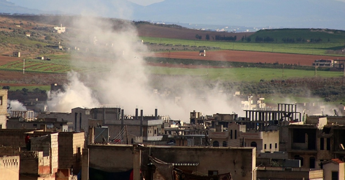Smoke rises above building reported shelling in the town of Khan Sheikhun in the southern countryside of the opposition-held Idlib province, on Feb. 28, 2019. (AFP Photo)