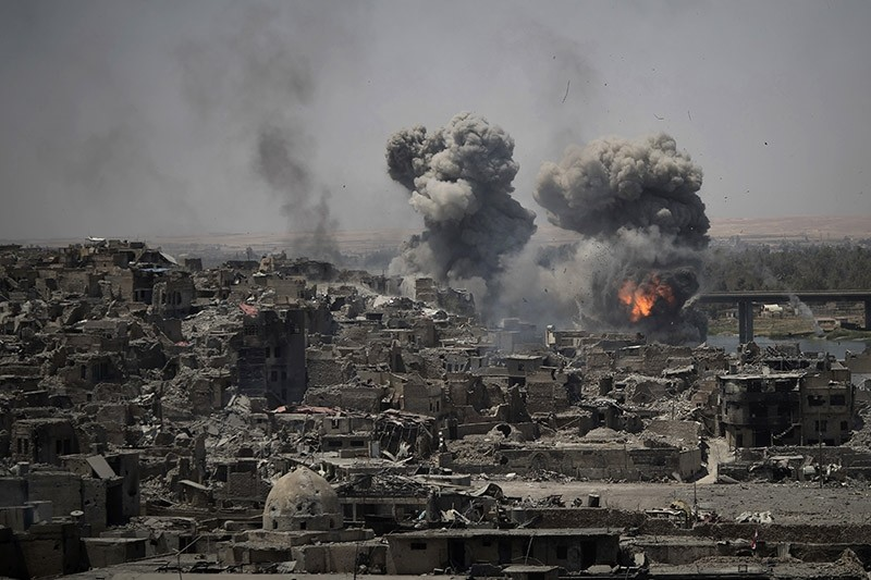 In this July 11, 2017 photo, airstrikes target Daesh positions on the edge of the Old City a day after Iraq's prime minister declared ,total victory, in Mosul, Iraq. (AP Photo)