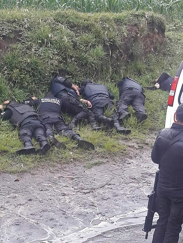 A handout photo made available by the news portal PueblaRoja shows the bodies of a group of police officers who were killed during a confrontation in the town of Chachapa, Amozoc municipality, Puebla, Mexico. (Via EPA)