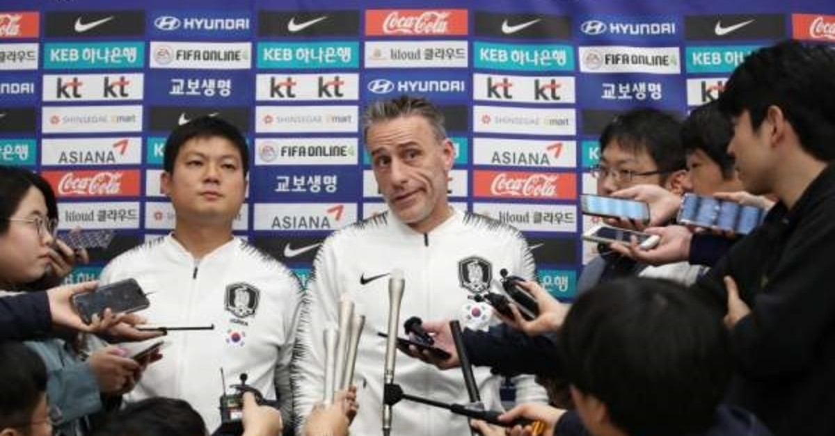 South Korea soccer coach Paulo Bento (C) speaks to reporters upon his arrival at Incheon International Airport, in Incheon, South Korea, October 17, 2019. (EPA)