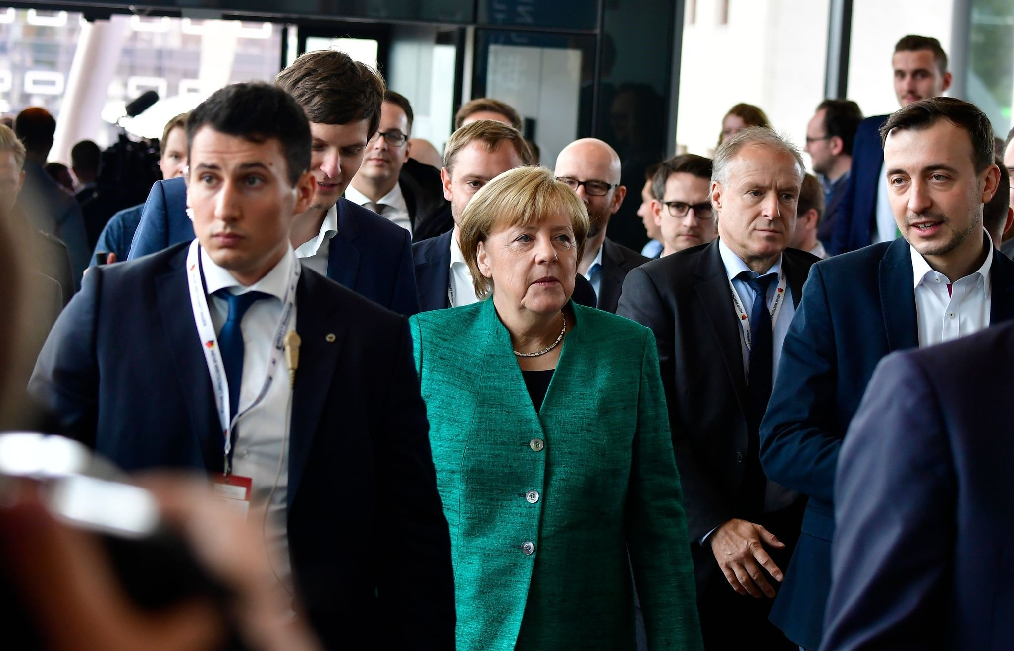 German Chancellor Angela Merkel (C) arrives to attend a congress of the Junge Union Deutschlands (JU, the joint youth organisation of the two conservative parties CDU and CSU) in Dresden. (AFP Photo)
